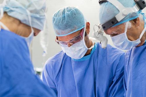 team-of-surgeons-operating-PANYLKC.jpg